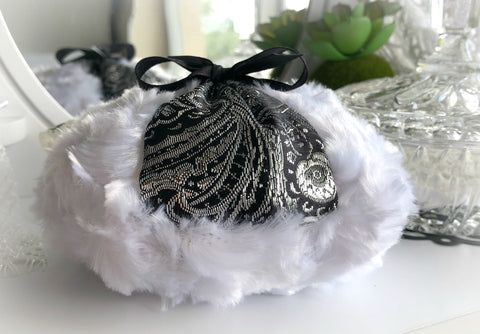 black and silver powder pouf