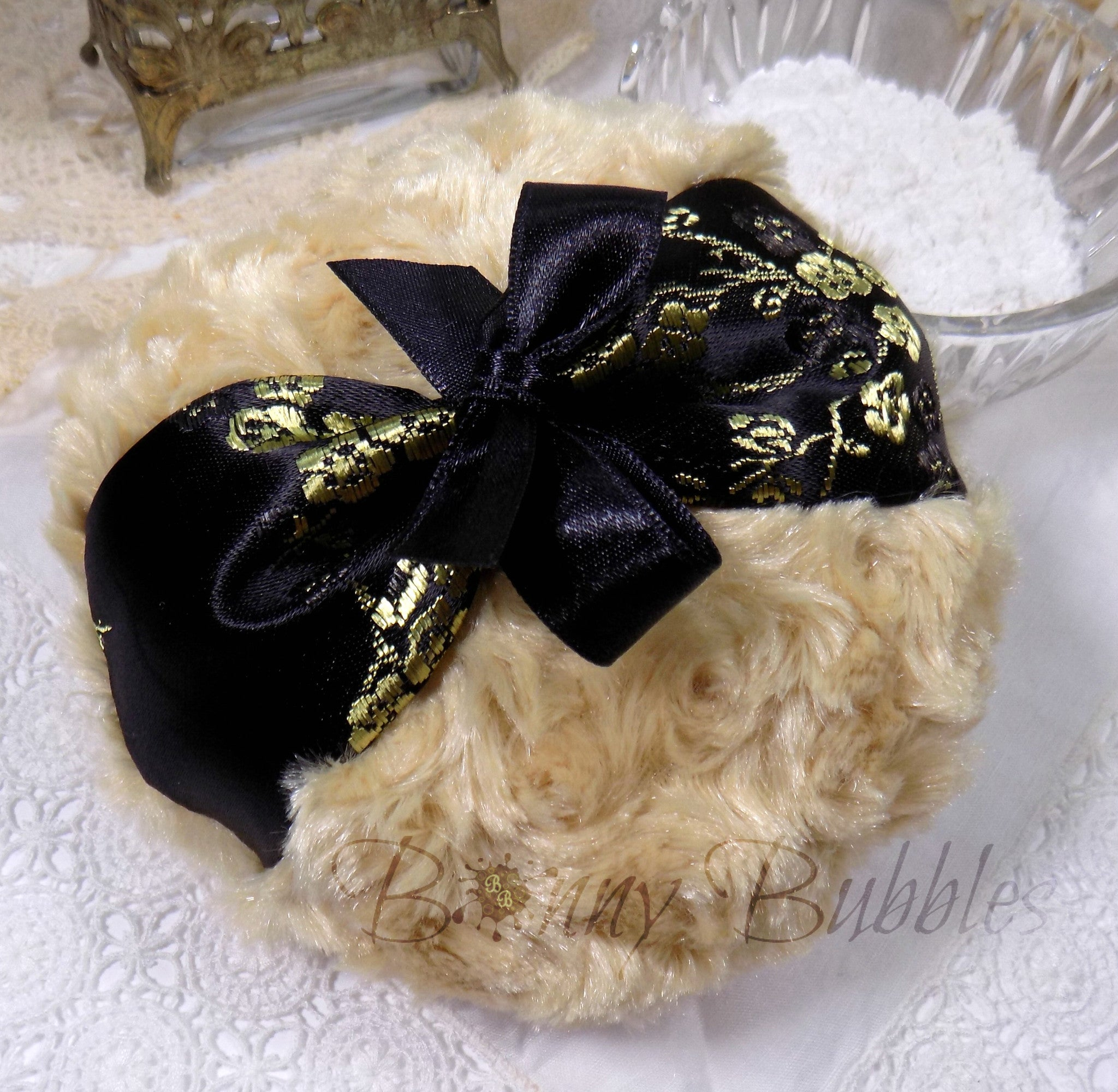 black and gold powder puff
