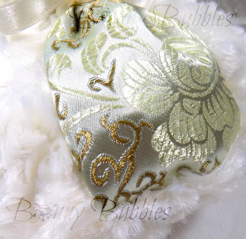 gold and ivory brocade puff