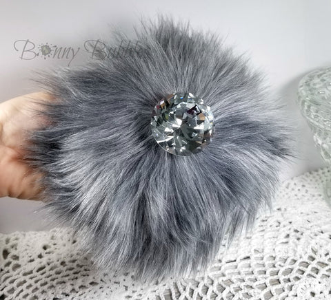 fluffy gray powder puff with handle