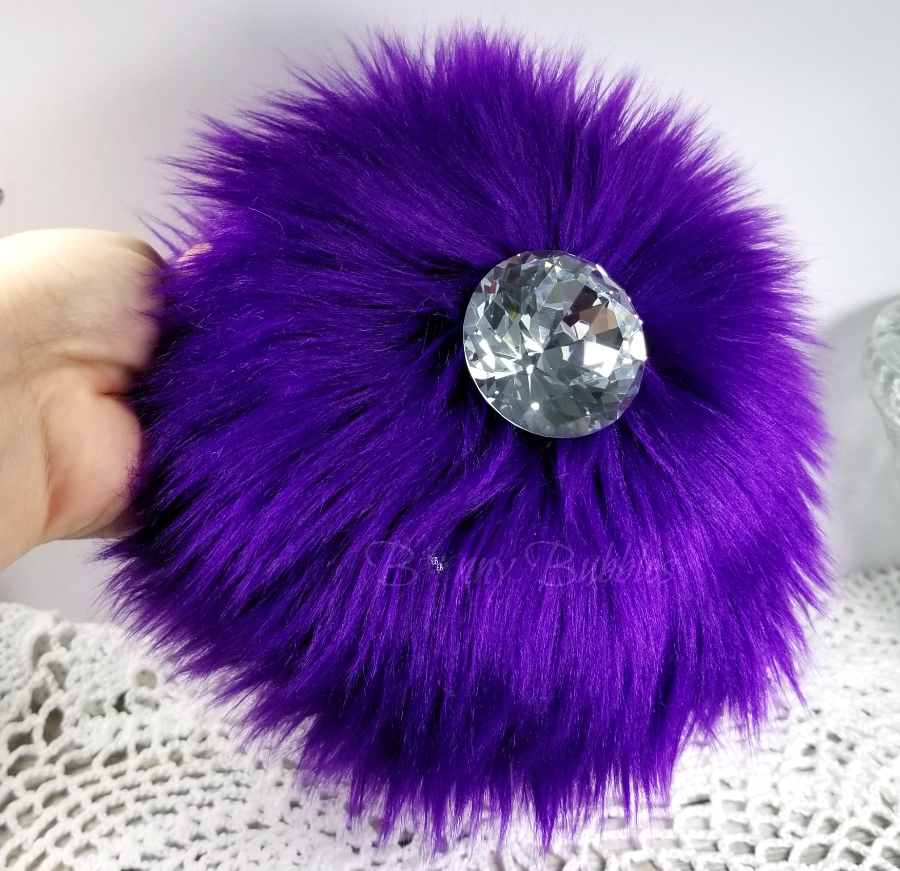 fluffy purple powder puff with handle