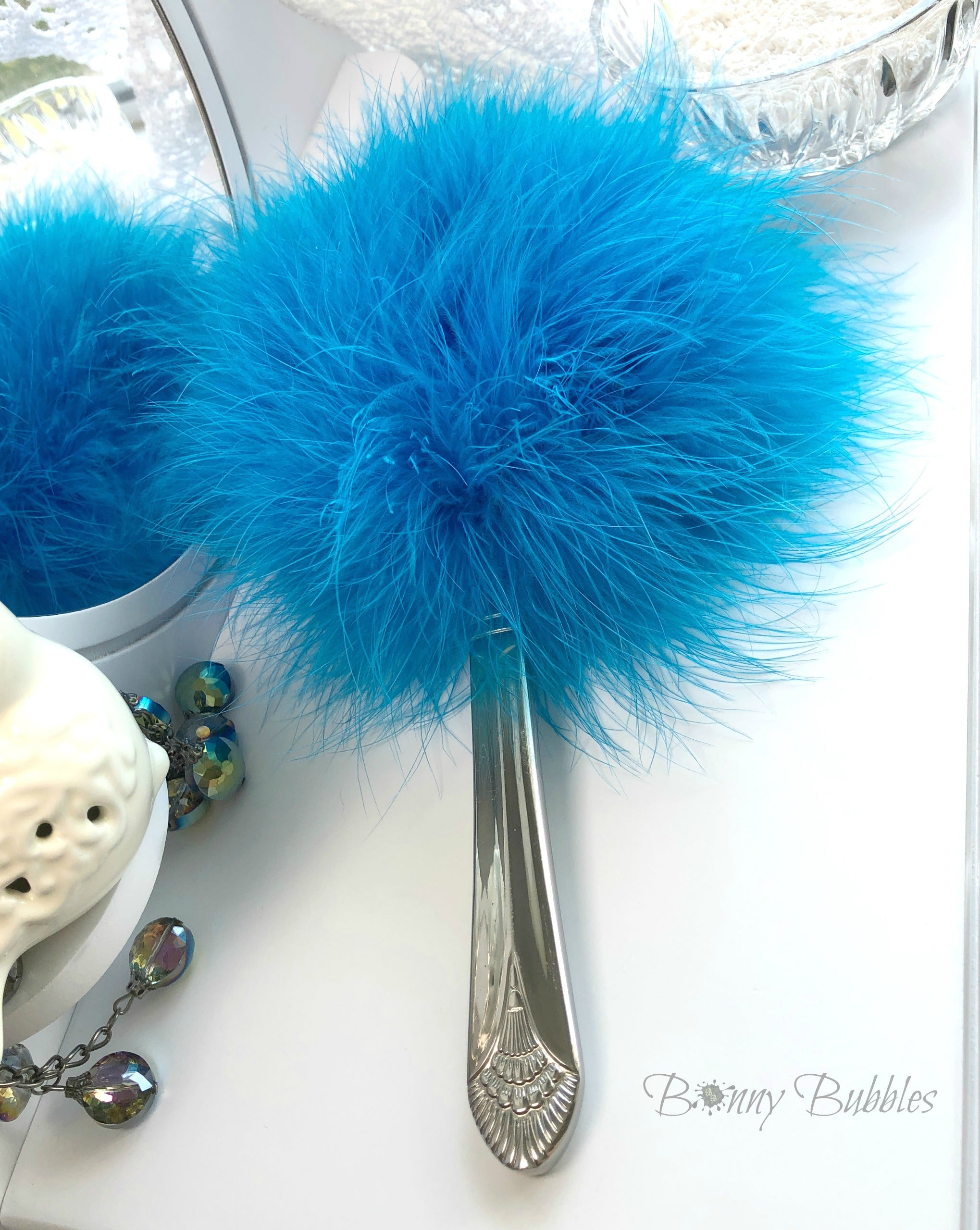 turquoise feather powder puff wand