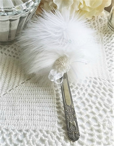 white powder puff wand