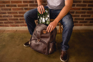 Genuine leather laptop backpack Nordweg NW072 with and iPad in front of a brick wall