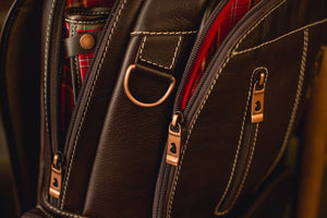 Details of zipper, metals, stitching and leather of the Nordweg NW072 laptop backpack