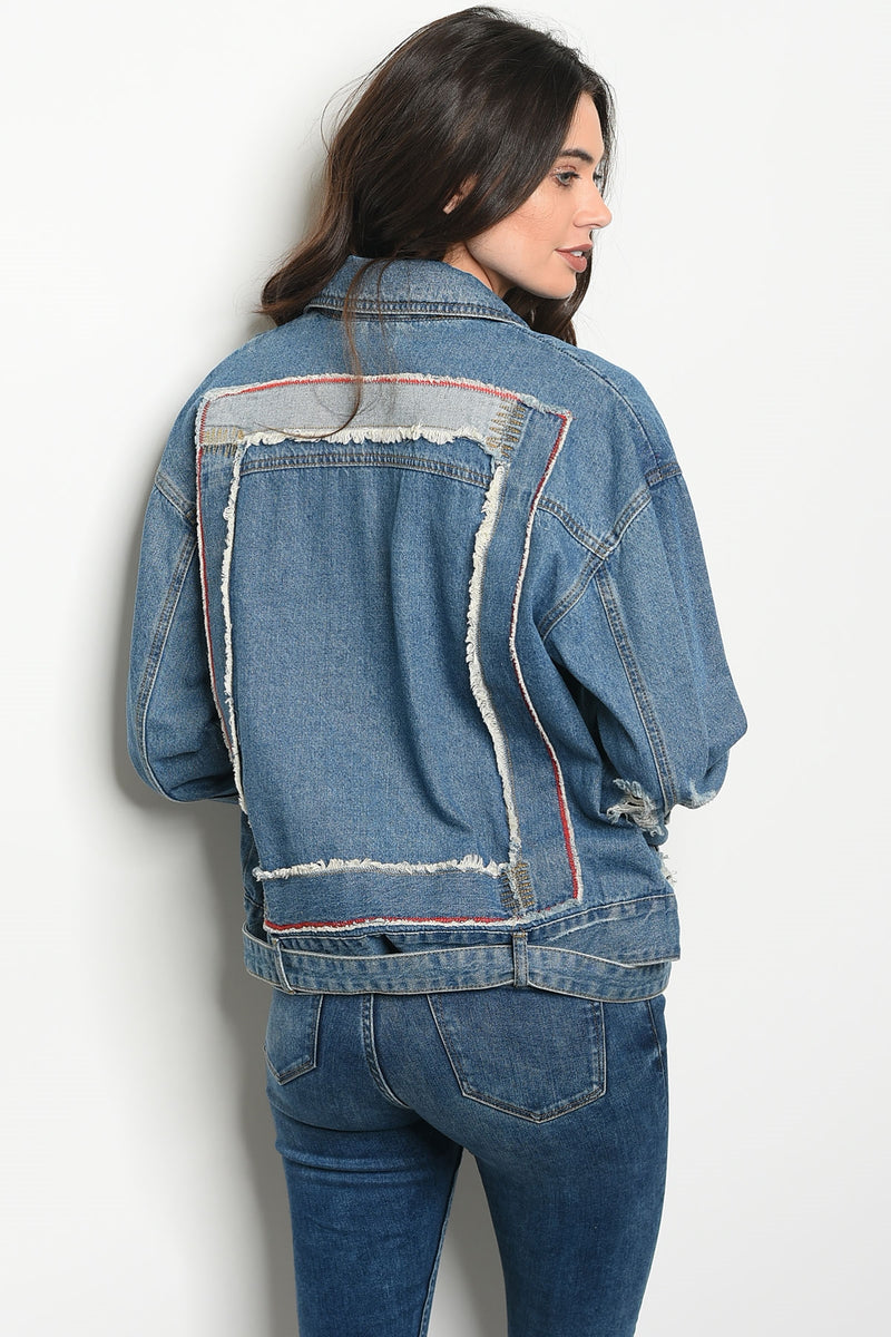 Ladies fashion moto style denim jacket that features a distressed detailed back and relaxed  collar