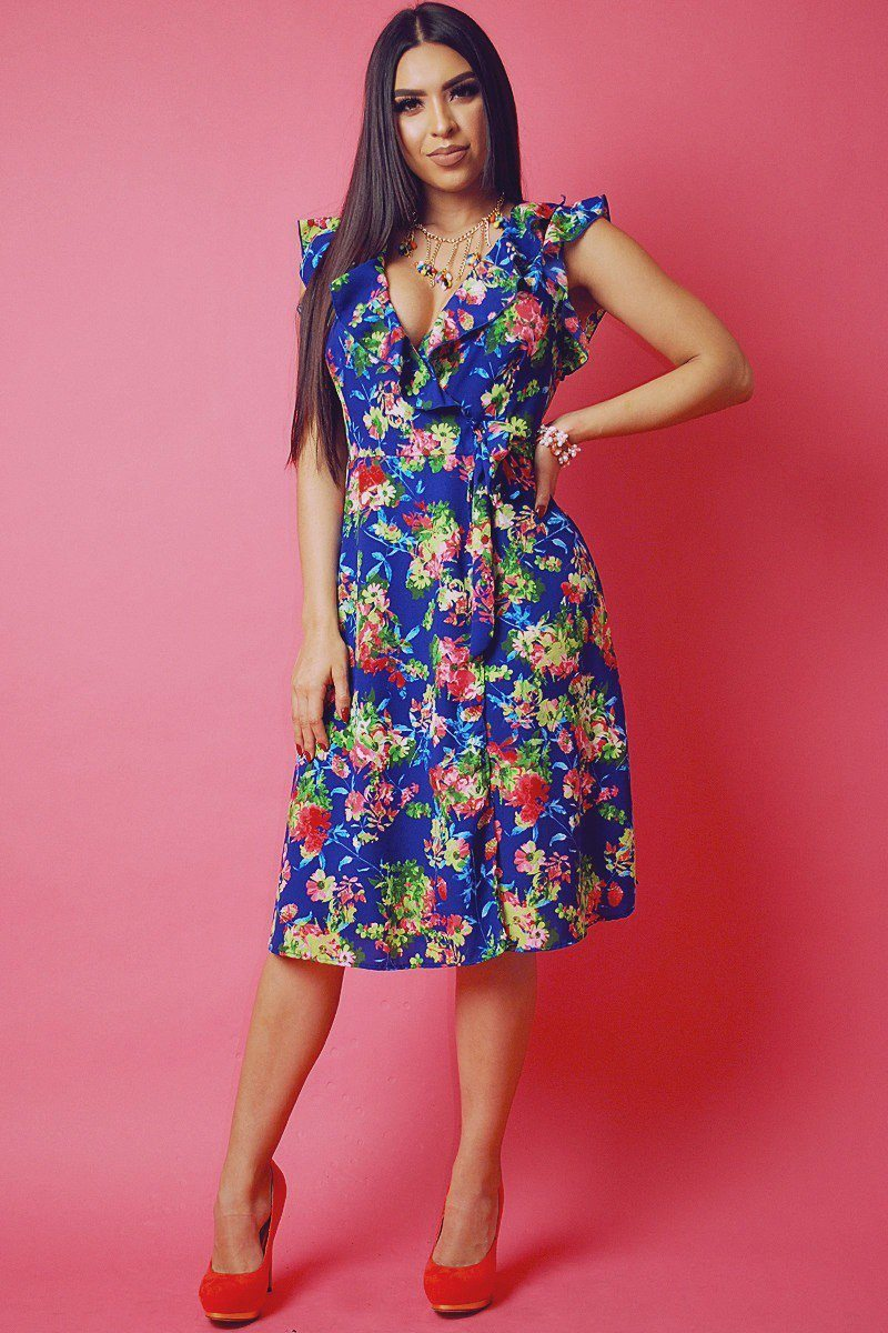 Floral print, sleeveless wrapped dress with v neckline and ruffled trim 95% Polyester 5% Spandex