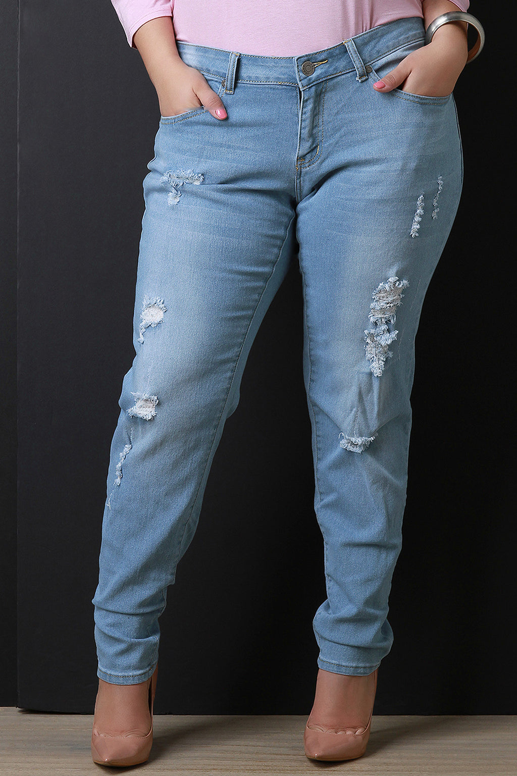 Distressed Mid Rise Denim Jeans