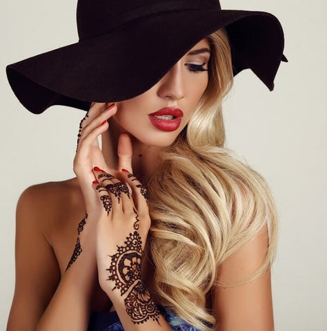 beautiful woman wearing hipsters hats