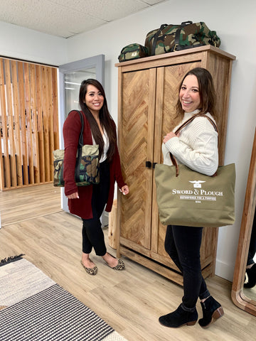 Kaye Paraoan and Amy Slinker with Sword & Plough bags in the WILCO SUPPLY showroom