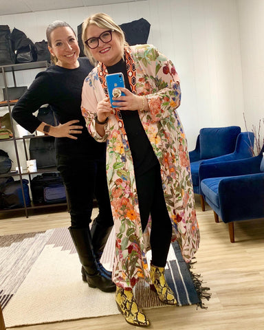 Tess Weaver and Amy Slinker in the WILCO SUPPLY showroom, with bags in the background