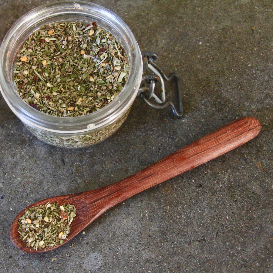 Camp Director's Handcrafted Herb + Spice Blend and small wooden spoon