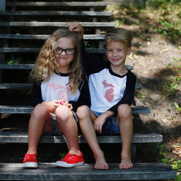 children wearing customizable GEO baseball tee