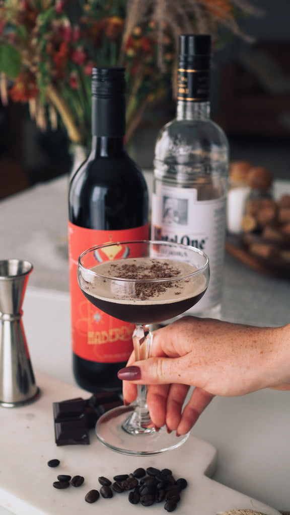 woman holding espresso cocktail