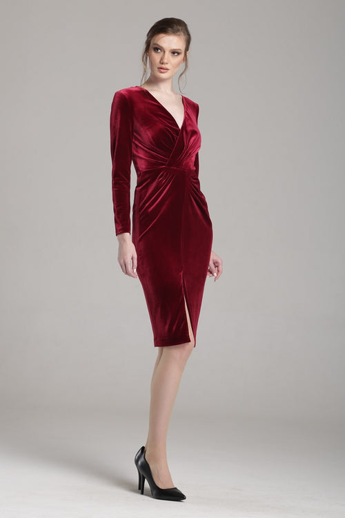 Velvet dress with v-neck neckline and draped detail in burgundy