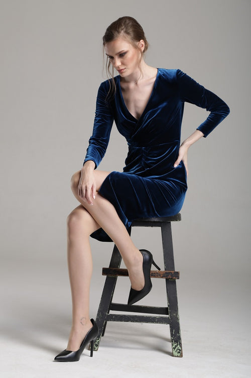 Velvet dress with v-neck neckline and draped detail in royal blue
