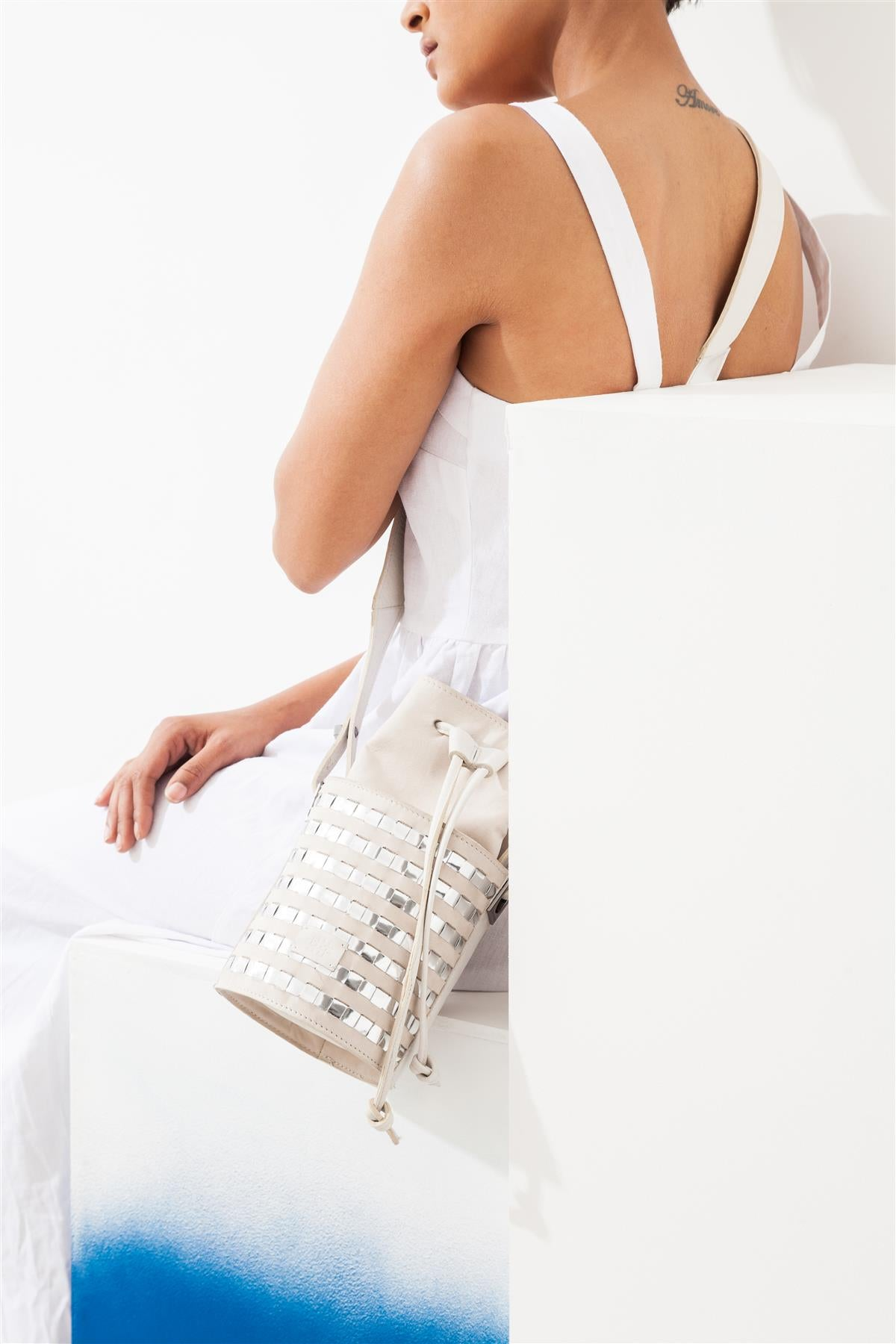 Mini circular bucket bag in cream with striped silver mirror effect