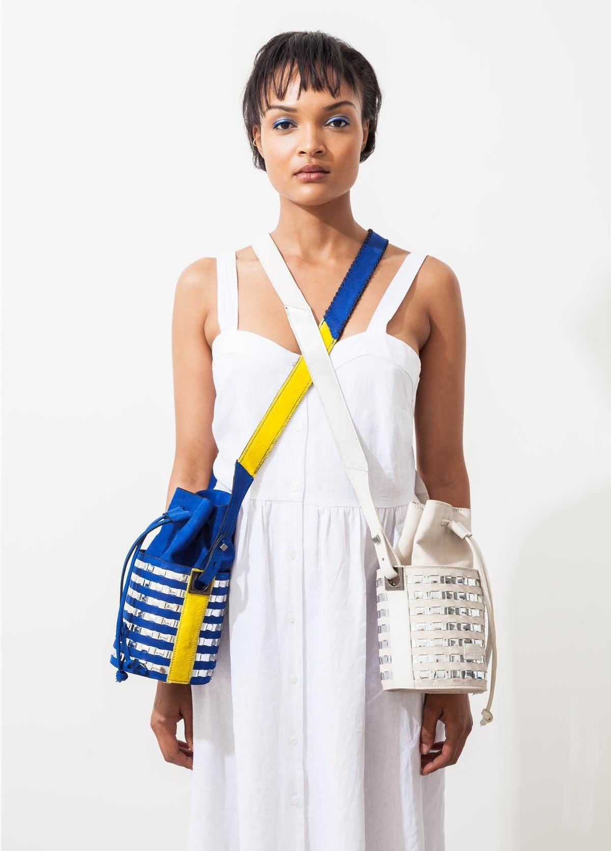Mini circular bucket bag in royal blue with striped silver mirror effect