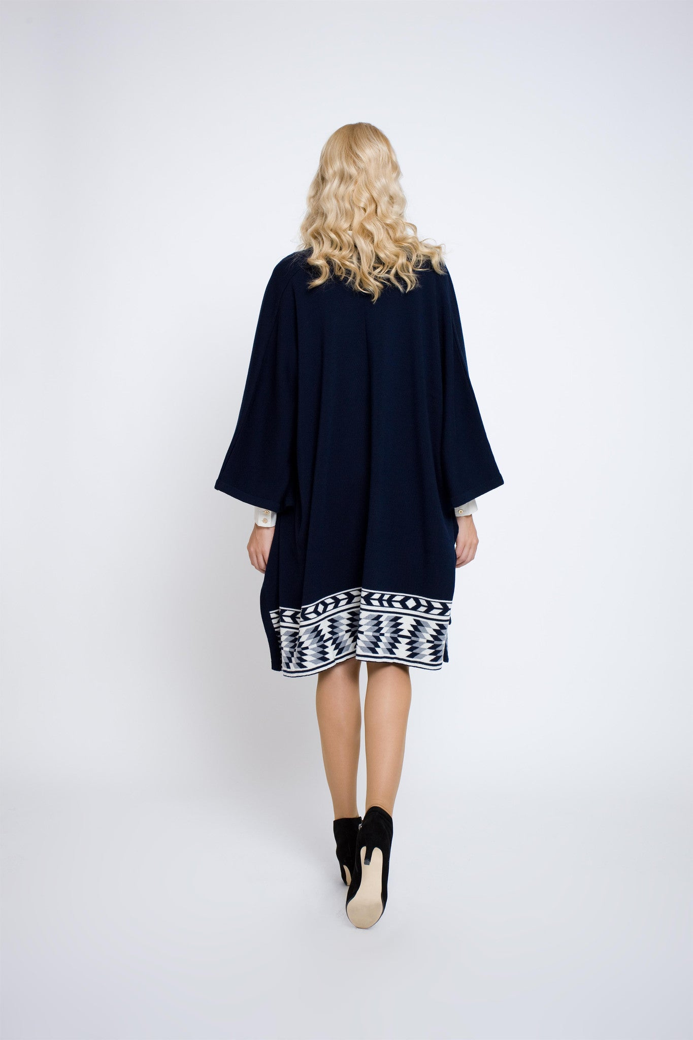 Wool merino cape with ethnic motifs