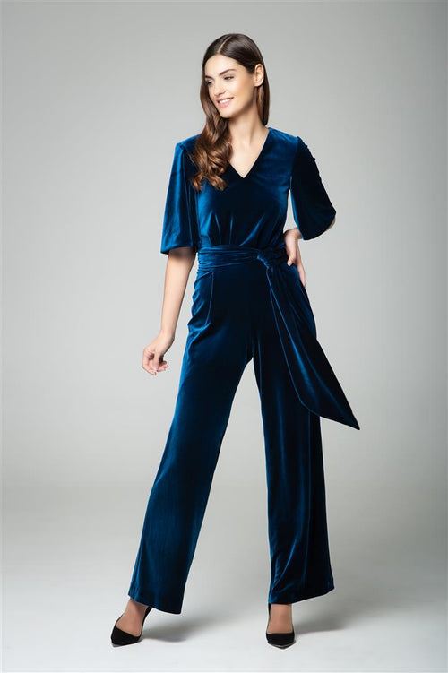 Velvet jumpsuit with bell sleeves and sash in royal blue