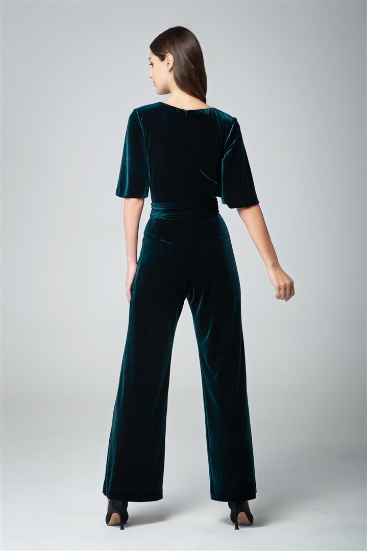 Velvet jumpsuit with bell sleeves and sash in emerald green