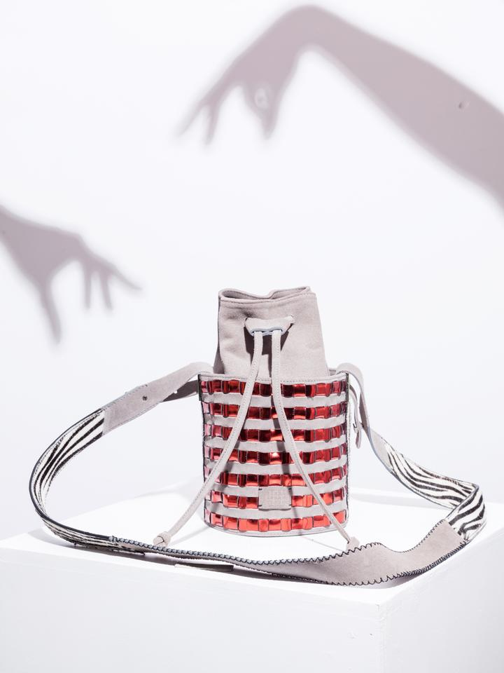 Mini circular bucket bag in grey with striped vino mirror effect