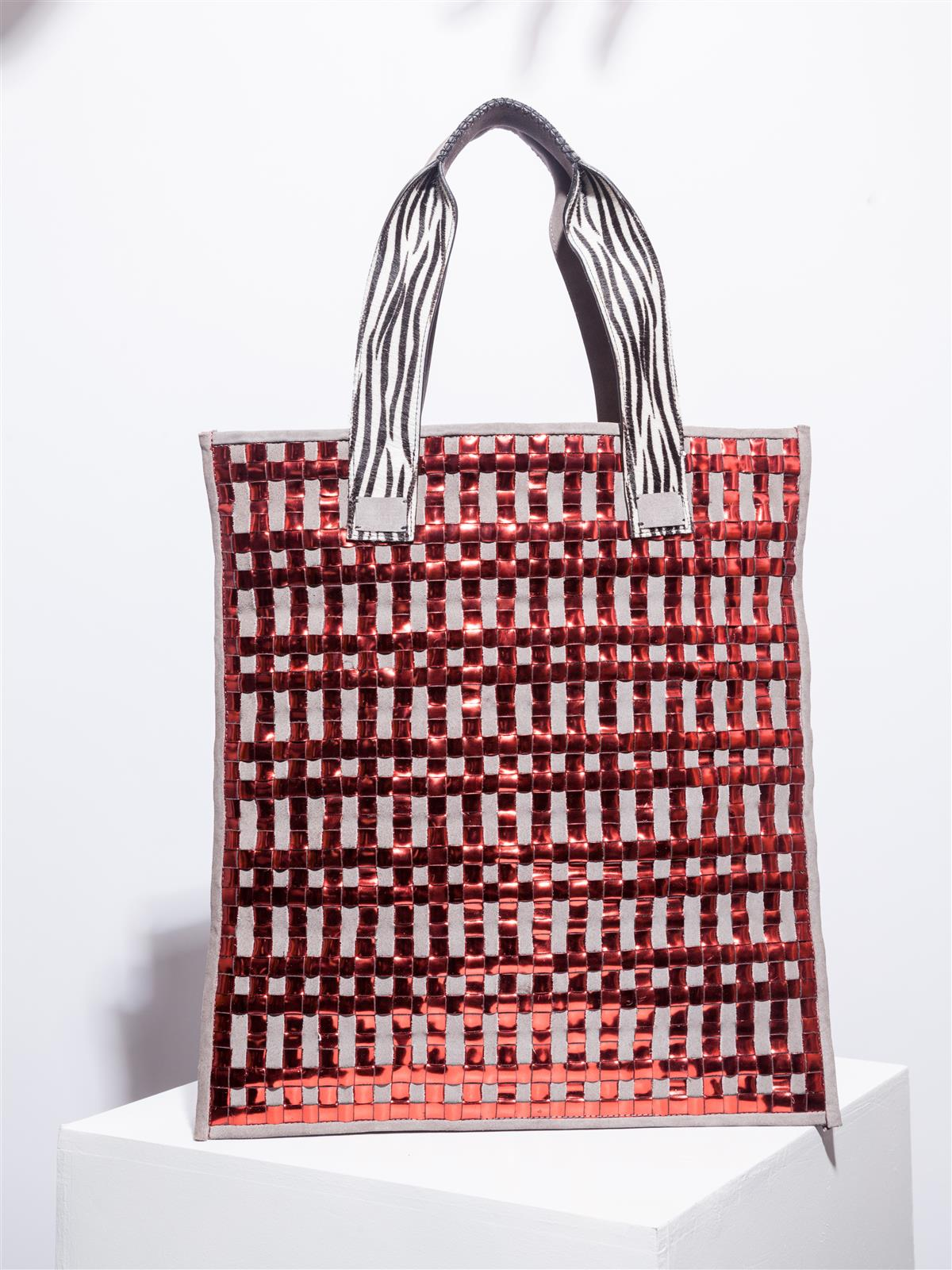 Stardust and mirror red tote with zebra details