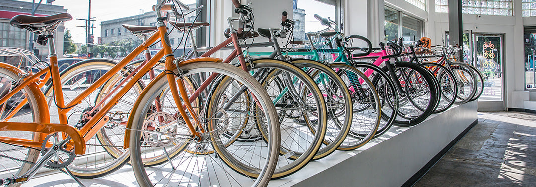 Banker Supply hand picks the best city bikes for urban cycling from brands like Pure Cycles, 6KU, Populo, Aventon, State Bicycle Co, Brooklyn Bicycles