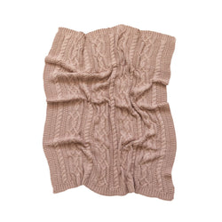 The Reilly Blanket by DiLusso is a Nude coloured Pram or Bassinet Blanket in a deliciously chunky cable knit!
