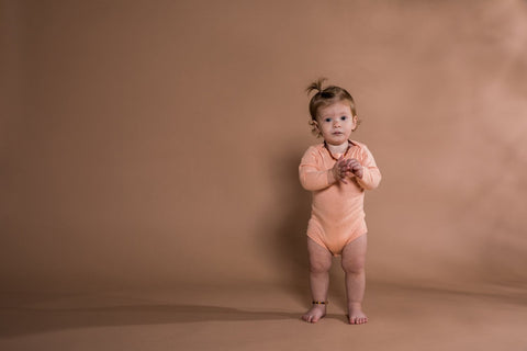Keep your little one Supercool in this delicious Apricot Pointelle Bodysuit by Grown. This lightweight fine-gauge knitted bodysuit made from GOTS certified organic cotton. This bodysuit has a pointelle knit detail, a cross over shoulder detail and button up crotch for easy for dressing.