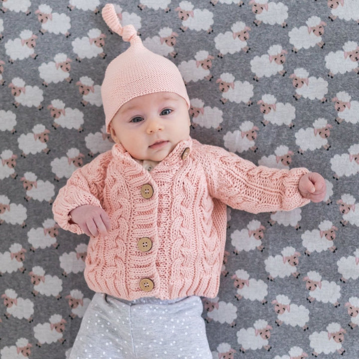 Keep your little one super cosy and warm in the Jamie Pink Cable Knit Cardigan by DiLusso!