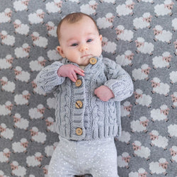 Keep your little one super cosy and warm in the Jamie Grey Cable Knit Cardigan by DiLusso!
