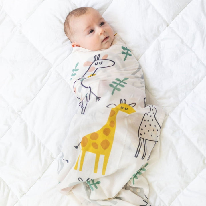Perfect for gifting is this super soft swaddle wrap featuring the very cute Georgie Giraffe motif by DiLusso Living!