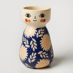 Do you wish your pots had more swag? This Miss Cozette Floral Blue Face Vase from Jones & Co. is for you!