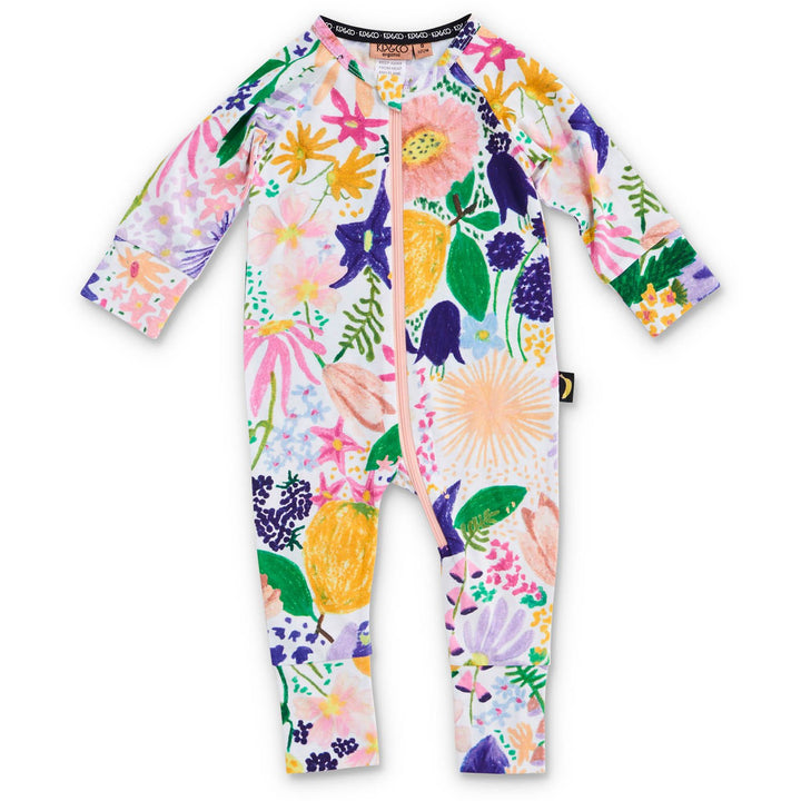 The Colourful Meadow Organic Long Sleeve Zip Romper from Kip & Co is the perfect pyjama for your little one!