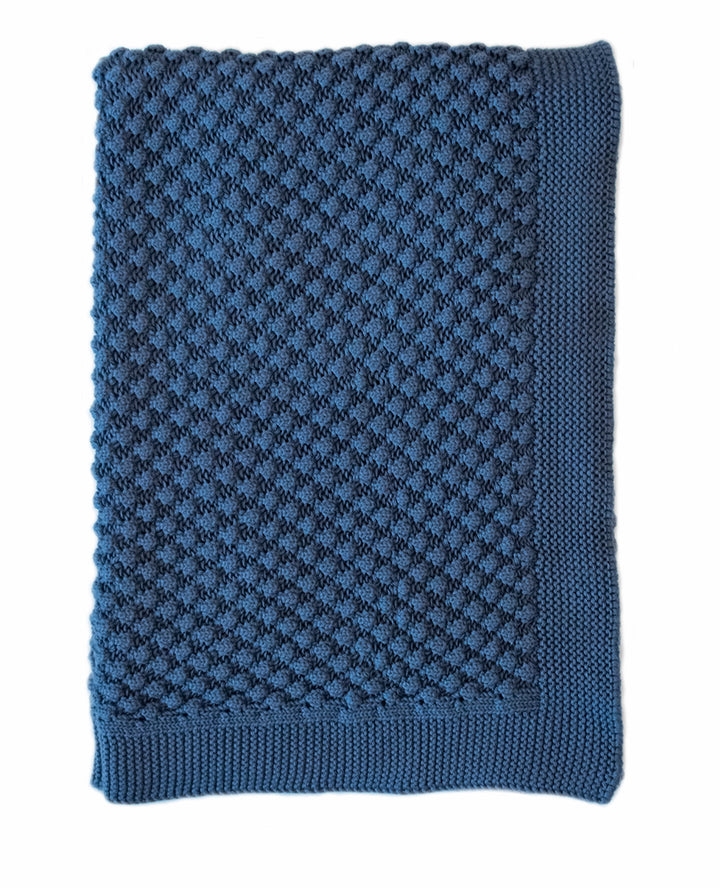 The Mini Popcorn Marine Blanket by Indus is the perfect complimentary solid to balance your patterned crib sheets!