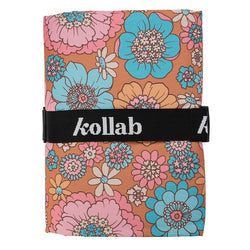 The Retro Aqua Floral Picnic Mat from Kollab is perfect for the park!