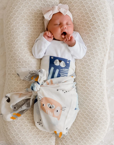 Your little one will be purring with happiness with the Kitty Kat Muslin Wrap from DiLusso Living.