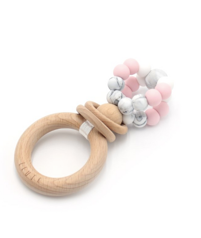 Ease your bubs teething with these Ring Pop Teethers in Marble Pink!  Designed by Lluie in Melbourne, Australia; the ring pop teething Rattle™ twists 360 degrees, rattles beautifully and allows for a good hearty chomping session!