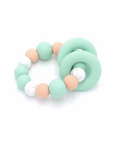 Ease your bubs teething with these Trio Teethers in Mint Speckle!  Designed by Lluie in Melbourne, Australia; the TRIO teether features 2 silicone donut rings which circulate the larger beaded silicone ring.