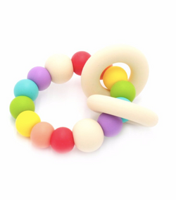 Ease your bubs teething with these Trio Teethers in Rainbow!  Designed by Lluie in Melbourne, Australia; the TRIO teether features 2 silicone donut rings which circulate the larger beaded silicone ring.