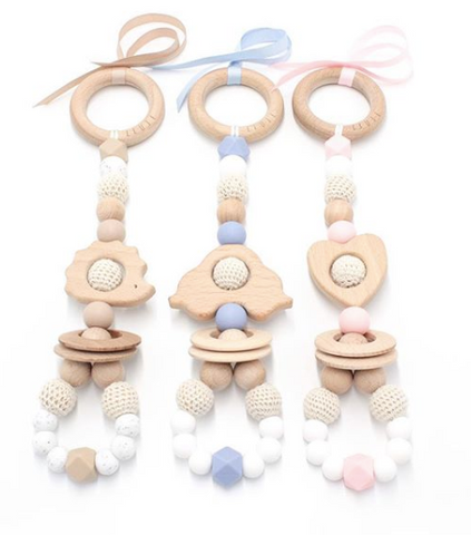 Ease your bubs teething with this Love Teething Rattle Toy in pink by Lluie! Encourages little ones to explore important milestones through tummy time or whilst lying on their backs.