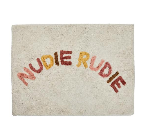 We love the Tula Nudie Bath Mat in Terra by Sage + Clare!  Cheeky 'Nudie Rudie' text adorns this tufted terra bath mat, adding a daily dose of fun to your bathroom.