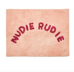 Do you have a Nudie Rudie in your house? Then, you might need this bath mat by Sage x Clare! Cheeky 'Nudie Rudie' text adorns this tufted blush bath mat, adding a daily dose of fun to your bathroom.
