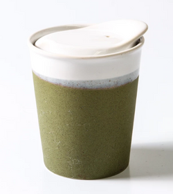 Want to save the planet but do it in style? Look no further than the Sprout Green Short Ceramic Coffee Cup by Indigo Love.