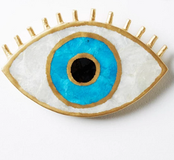 Looking for the perfect accent for your wall? Look no further than the evil eye wall art by Jones & Co.