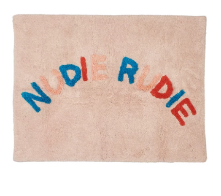 The Tula Nudie Bath Mat- Soleil!  Contrasting coloured Cheeky 'Nudie Rudie' text adorns this tufted parchment background, combining some of the new season's key colours.