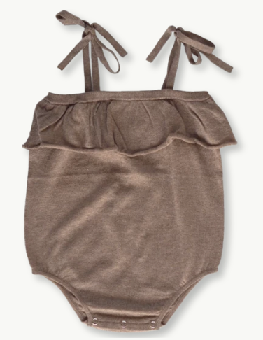 The Mushroom Frill Romper by Grown Clothing.  Lightweight romper in the softest yarn with ties at the shoulder and a frill. This romper has press snaps at the crotch seam for easy dressing.