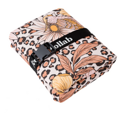 We love the Leopard Floral Picnic Mat. The Kollab mats are designed with an adjustable strap so that they don't need to be folded in any specific way. Just fold or roll it up however you please and adjust the strap to suit.