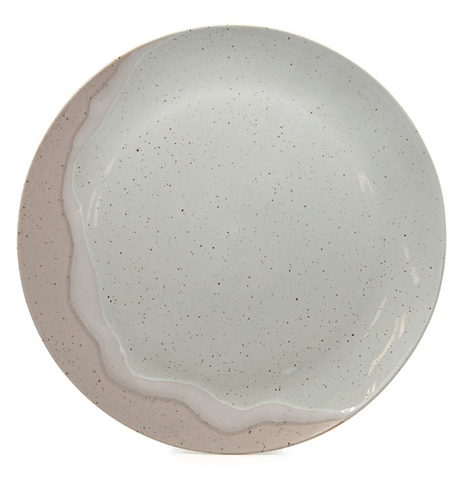 The 28cm Natural Roam Dinner Plate by Salt & Pepper.   Crafted from speckled pottery, this plate embodies elegance and flow with its two-colour hand-dipped aesthetic
